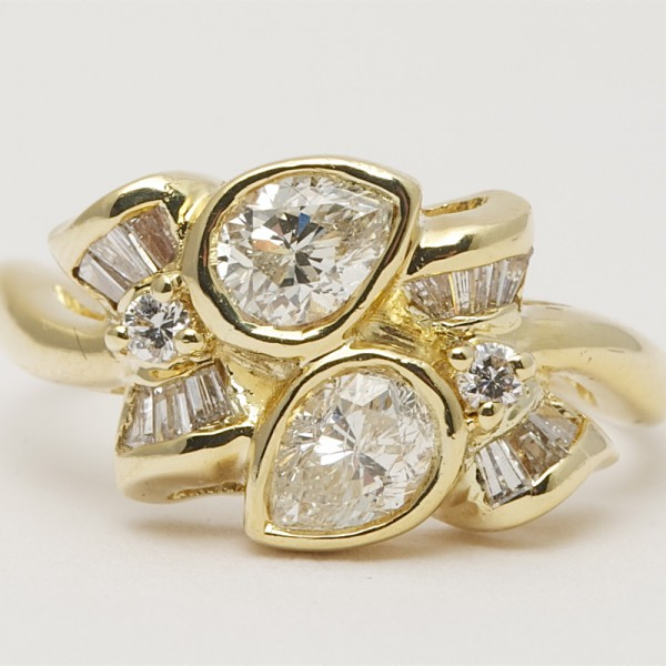 18k-Yellow-Gold-Ring-set-with-Pear-Shaped-Brilliant-Cut-Tapered-Baguette-Cut-Diamonds.jpg