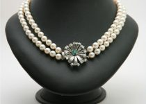 Double-Row-of-7.5-8mm-Cultured-Pearls-with-Vintage-18k-White-Gold-Clasp-set-with-Old-Cut-Diamonds-Emerald-Cut-Emerald.jpg