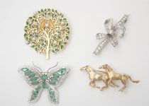 Selection of 9k & 18k Gold Brooches set with Diamonds & Other Gemstones